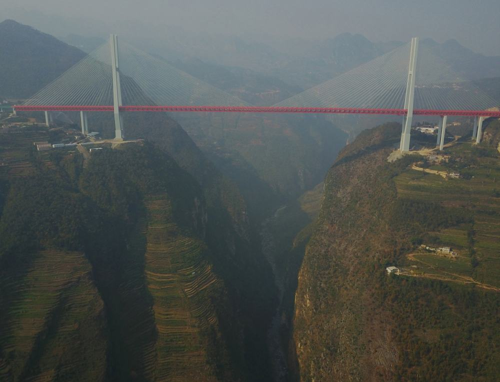 An aerial view shows the Beipanjiang Bridge, connecting Guizhou and Yunnan provinces, which is reported as world's highest bridge according to local media